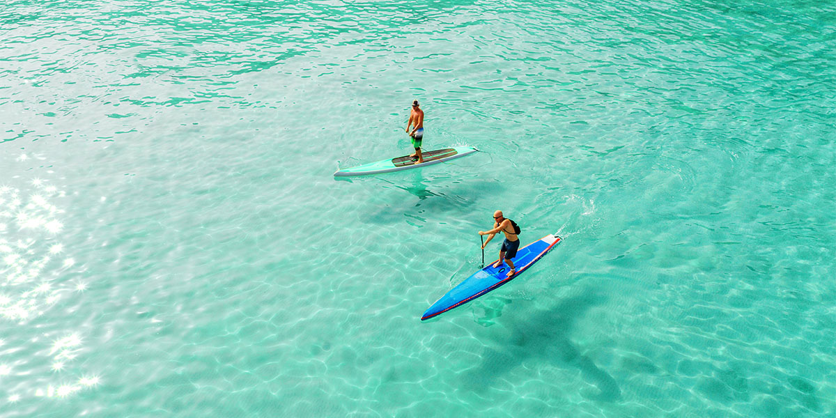 Prove your balance practising stand up paddle surfing in Zanzibar