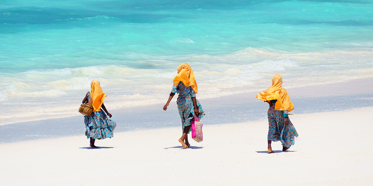 Kids walking on Paje Beach in Zanzibar